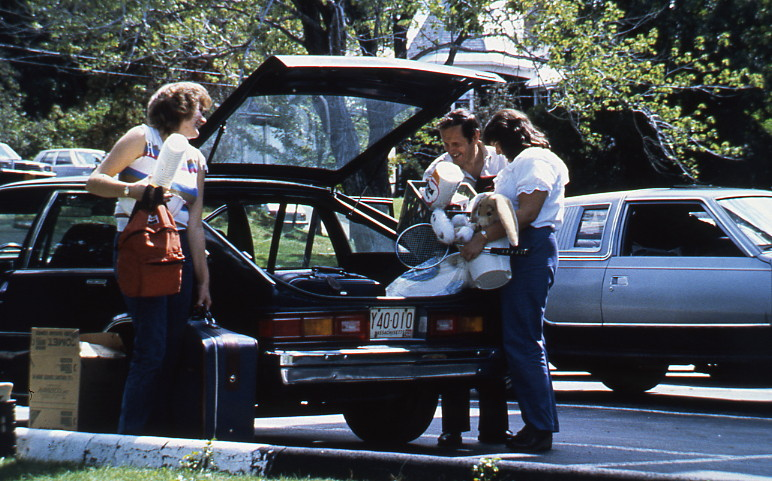Unpacking the car, c. 1980, Champlain College Archives